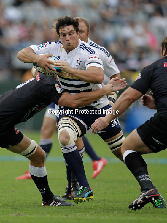 Stormers flanker Francois Louw is tackled by Sharks player Jannie du Plessis during a Super 15 rugby match in Durban, 2 April , 2011. Sportzpics