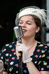 Vicky White of the singing duo Jump Jive and Swing<br /> <br /> 26-27 July 2014<br /> Image © Paul David Drabble <br /> www.pauldaviddrabble.co.uk