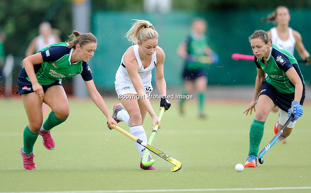 Electric Ireland 4 Nations, National Hockey Stadium, UCD 12/7/2014 <br /> Ireland vs New Zealand<br /> New Zealand&rsquo;s Anita Punt with Stella Davis and Cliodhna Sargent of Ireland<br /> Mandatory Credit &copy;INPHO/Tommy Grealy