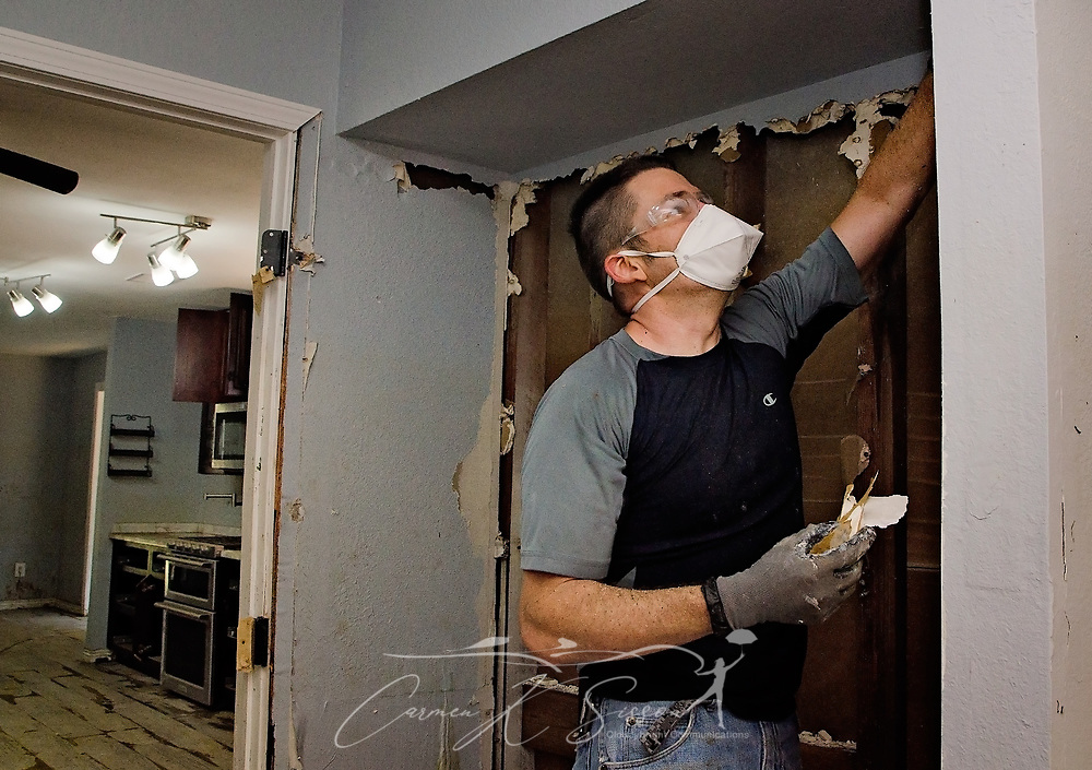 Southern Baptist Disaster Relief volunteer Sean Curry, of Champion Forest Baptist Church in Houston, pulls flood-damaged sheetrock from a home, Sept. 6, 2017, in Houston, Texas. Homeowner Paul Matlock's home was inundated with more than six feet of water when Hurricane Harvey dumped more than 51 inches of rainfall in mid-August. Approximately 70 people died in the U.S. due to the hurricane and flooding, but that number is expected to rise as water levels fall, allowing rescuers to reach more areas. (Photo by Carmen K. Sisson)