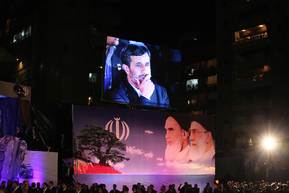Iranian President Mahmoud Ahmadinejad arrived in Beirut this morning for the start of a two-day trip to Lebanon. After visits around Beirut, Ahmadinejad ended the day by speaking at a Hizballah-organized rally attended by tens of thousands in Beirut's southern suburbs. At the rally, Hizballah head Hassan Nasrallah also addressed the crowd from a video link.///Iranian President Mahmoud Ahmadinejad listens to Hassan Nasrallah deliver his speech.