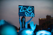 A fan of the band Zoé holds her sign above the crowd on day one of Ruido Fest.