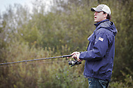 Bryan Clay and Jeremy Campbell are accustomed to competing in front of tens of thousands of spectators in some of the world's greatest sporting arenas, but today the American athletic stars were the picture of relaxation as they indulged in a spot of fishing on the banks of the River Tay.. .Clay, the reigning Olympic decathlon champion, and Campbell, who scooped gold in the pentathlon and discus at the 2008 Paralympics in Beijing, were staying at the East Haugh Hotel, Pitlochry, at the weekend  as part of a drive to promote UK tourism ahead of next year's 2012 London Olympic Games.. .The two athletes, whose tour of Scotland has been organised by VisitScotland and VisitBritain in co-operation with the U.S. Olympic Committee, were in Pitlochry as part of Team USA: Britain Bound. The athletes will document their tour of Scotland, including their visit to Perthshire, through images, video and blogs posted on www.TeamUSA.org/BritainBound.. .Pic shows Jeremy fishing