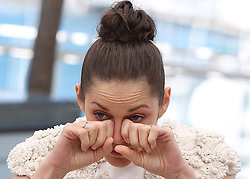 59692003 .French actress Marion Cotillard reacts during a photocall for the film The Immigrant at the 66th edition of the Cannes Film Festival in Cannes, on May 24, 2013. ..UK ONLY