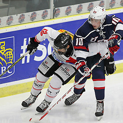 COBOURG, - Dec 16, 2015 -  Game #7 - United States vs Switzerland at the 2015 World Junior A Challenge at the Cobourg Community Centre, ON. Cyril Oehen #10 of Team Switzerland and Liam Pecararo #19 of Team United States battle for the puck during the second period.(Photo: Tim Bates / OJHL Images)