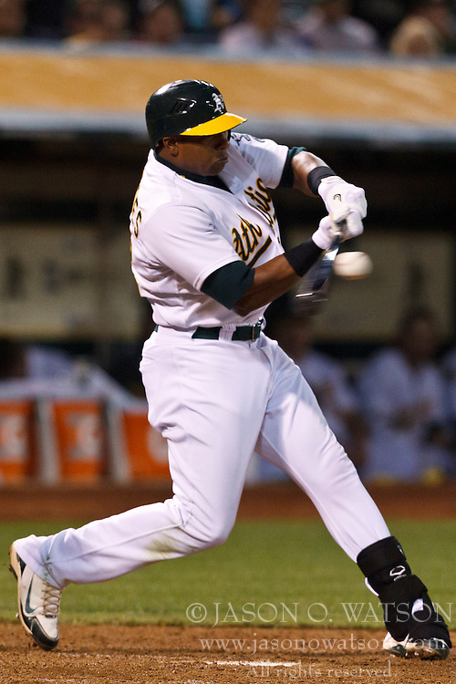 OAKLAND, CA - AUGUST 02: Yoenis Cespedes #52 of the Oakland Athletics at bat against the Toronto Blue Jays during the seventh inning at O.co Coliseum on August 2, 2012 in Oakland, California. The Oakland Athletics defeated the Toronto Blue Jays 4-1. (Photo by Jason O. Watson/Getty Images) *** Local Caption *** Yoenis Cespedes