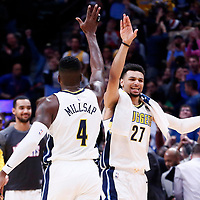 09 November 2017: Denver Nuggets forward Paul Millsap (4) celebrates with Denver Nuggets guard Jamal Murray (27) during the Denver Nuggets 102-94 victory over the Oklahoma City Thunder, at the Pepsi Center, Denver, Colorado, USA.