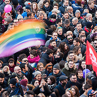 Milan, Italy - 23-01-2016: Demonstrators wave rainbow flags in Piazza Scala to support the approval of the Cirinnà law on civil unions.