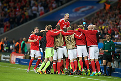 5LILLE, FRANCE - Friday, July 1, 2016: Wales' Aaron Ramsey jumps up as the team celebrate the equalising goal by captain Ashley Williams  to make the score 1-1 during the UEFA Euro 2016 Championship Quarter-Final match against Belgium at the Stade Pierre Mauroy. (Pic by Paul Greenwood/Propaganda)