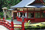 Iwaki shrine on the side of Mt. Iwaki which is a volcano and a very sacred mountain. This is a summer scene of the shrine's shop which sells good luck charms.