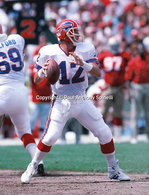 Buffalo Bills quarterback Jim Kelly (12) throws a pass during the NFL preseason football game against the San Francisco 49ers on Sept. 13, 1992 in San Francisco. The Bills won the game 34-31. (©Paul Anthony Spinelli)