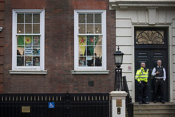 © Licensed to London News Pictures. 29/01/2018. London, UK. A Kurdish women's group occupy Conservative Central Office. Police say the group of 12, who are calling on a ban of arms sales to Turkey, entered the building just before 2pm. They left peacefully after an hour . Photo credit: Peter Macdiarmid/LNP