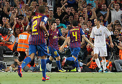 17.08.2011, Camp Nou, Barcelona, ESP, Supercup 2011, FC Barcelona vs Real Madrid, im Bild FC Barcelona's Daniel Alves, Leo Messi and Cesc Fabregas celebrates goal in presence of Real Madrid's Ricardo Carvalho (r)dejected during Spanish Supercup 2nd match.August 17,2011. EXPA Pictures © 2011, PhotoCredit: EXPA/ Alterphotos/ Acero +++++ ATTENTION - OUT OF SPAIN / ESP +++++