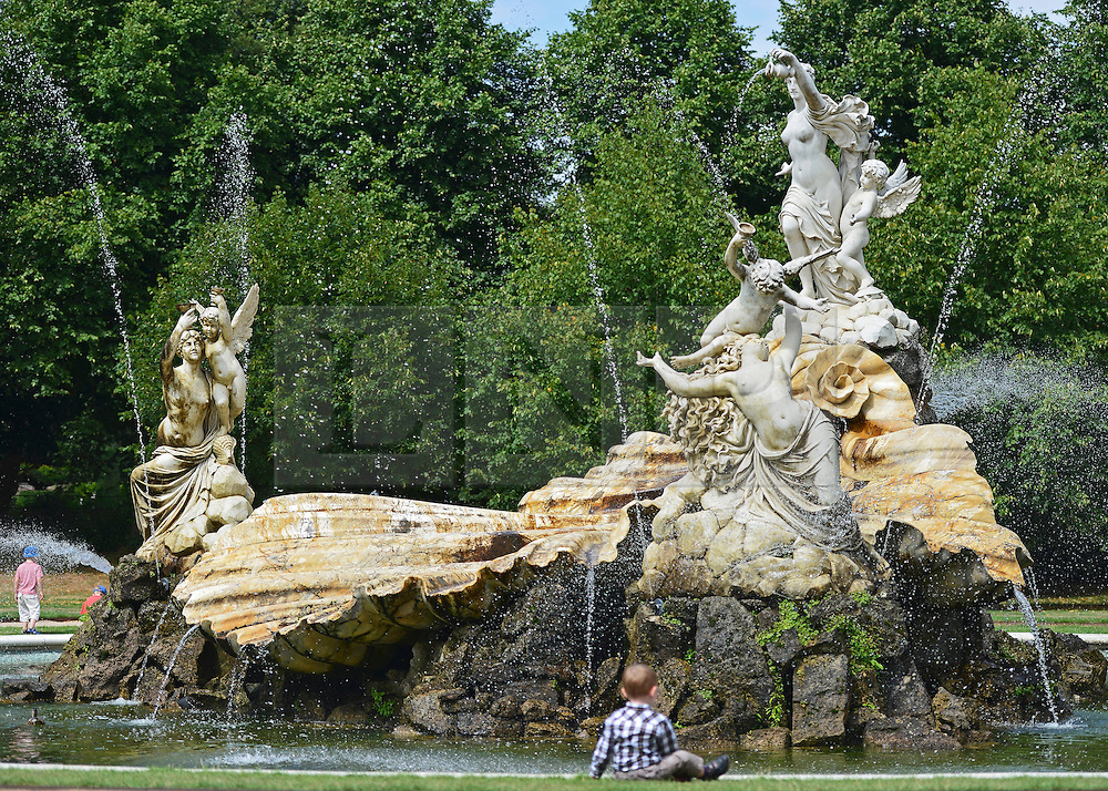 © Licensed to London News Pictures. 14/08/2013. Cliveden, UK .The Fountain of Love. People enjoy the warm weather today, 14th August 2013, in the grade 1 listed grounds of Cliveden, a National Trust property in Maidenhead, Buckinghamshire. Photo credit : Stephen Simpson/LNP