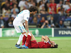 May 26, 2018 - Kiev, Ukraine - Liverpool's Egyptian forward Mohamed Salah is comforted by Real Madrid's Marcelo as he leaves the pitch after injury during the UEFA Champions League final football match between Liverpool and Real Madrid at the Olympic Stadium in Kiev, Ukraine on May 26, 2018. (Credit Image: © Raddad Jebarah/NurPhoto via ZUMA Press)
