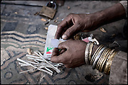 "White powder. Pure heroin. Rawalpindi, Pakistan, on thursday, November 27 2008.....""Pakistan is one of the countries hardest hits by the narcotics abuse into the world, during the last years it is facing a dramatic crisis as it regards the heroin consumption. The Unodc (United Nations Office on Drugs and Crime) has reported a conspicuous decline in heroin production in Southeast Asia, while damage to a big expansion in Southwest Asia. Pakistan falls under the Golden Crescent, which is one of the two major illicit opium producing centres in Asia, situated in the mountain area at the borderline between Iran, Afghanistan and Pakistan itself. .During the last 20 years drug trafficking is flourishing in the Country. It is the key transit point for Afghan drugs, including heroin, opium, morphine, and hashish, bound for Western countries, the Arab states of the Persian Gulf and Africa..Hashish and heroin seem to be the preferred drugs prevalence among males in the age bracket of 15-45 years, women comprise only 3%. More then 5% of whole country's population (constituted by around 170 milion individuals),  are regular heroin users, this abuse is conspicuous as more of an urban phenomenon. The substance is usually smoked or the smoke is inhaled, while small number of injection cases have begun to emerge in some few areas..Statistics say, drug addicts have six years of education. Heroin has been identified as the drug predominantly responsible for creating unrest in the society."""