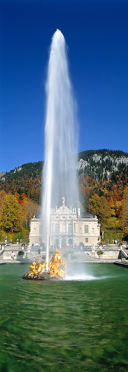 A golden fountain spews a forty-foot stream of water, at Linderhof Castle, Bavaria, Germany.