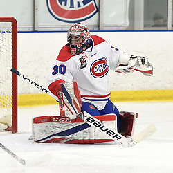 TORONTO, ON  - JAN 7,  2018: Ontario Junior Hockey League game between the Toronto Jr. Canadiens and the Buffalo Jr. Sabres, Christian Mattiace #30 of the Toronto Jr. Canadiens follows the play during the first period.<br /> (Photo by Andy Corneau / OJHL Images)