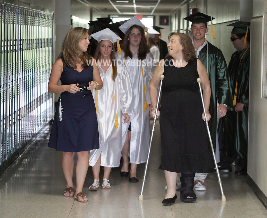 Senior class advisors Kelly Gillan, left, and Lynn Destefano lead the Minisink Valley class of 2010 out of the high school at the start of commencement in Slate Hill on Friday, June 25, 2010.