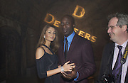 OSWALD  AND GYUNEL BOATENG. De Beers, Talisman launch party. The Shunt Vaults, 20 Stainer Street, London, SE1, 28  November 2005. ONE TIME USE ONLY - DO NOT ARCHIVE  © Copyright Photograph by Dafydd Jones 66 Stockwell Park Rd. London SW9 0DA Tel 020 7733 0108 www.dafjones.com