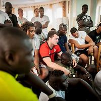 11/06/2013. Dakar, Senegal. Les joueurs de l'équipe du Senegal visionnent un documentaire sur la federation de rugby  quelques heures avant le premier match de la demi-finale de la Coupe d'Afrique des Nations B contre la Namibie. ©Sylvain Cherkaoui