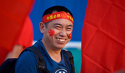 NANNING, CHINA - Thursday, March 22, 2018: A street vendor sells flags and scarves during the opening match of the 2018 Gree China Cup International Football Championship between China and Wales at the Guangxi Sports Centre. (Pic by David Rawcliffe/Propaganda)