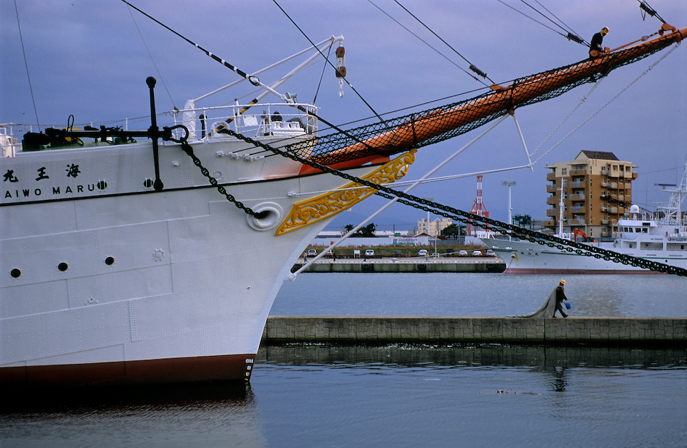 Japan, Toyama, Shiminato. November/13/2004...Two crew members work on the Kaiwo Maru tallship docked in Shiminato Port in Toyama, Japan.