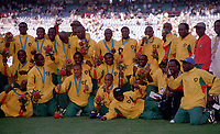 The Cameroon squad including Lauren show off there medals. Cameroon v Spain. The Football Final. The Sydney Olympics, 30/9/00. Credit: Colorsport / Andrew Cowie.
