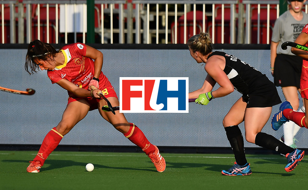 BRUSSELS, BELGIUM - JUNE 21: Erin Goad (R) of New Zealand and Julia Pons (L) of Spain during the FINTRO Women's Hockey World League Semi-Final Pool B game between New Zealand and Spain on June 21, 2017 in Brussels, Belgium. (Photo by Charles McQuillan/Getty Images for FIH)