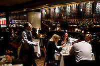 "9 December, 2008. New York, NY. Customers are here at the Craft restaurant in Manhattan, NY. Tom Collichio at Craft is ""on stage"" for customers in the open kitchen of Craft's dining room, a New York restaurant. Several restaurants offer special seatings with their celebrity chefs.<br /> <br /> ©2008 Gianni Cipriano for The New York Times<br /> cell. +1 646 465 2168 (USA)<br /> cell. +1 328 567 7923 (Italy)<br /> gianni@giannicipriano.com<br /> www.giannicipriano.com"