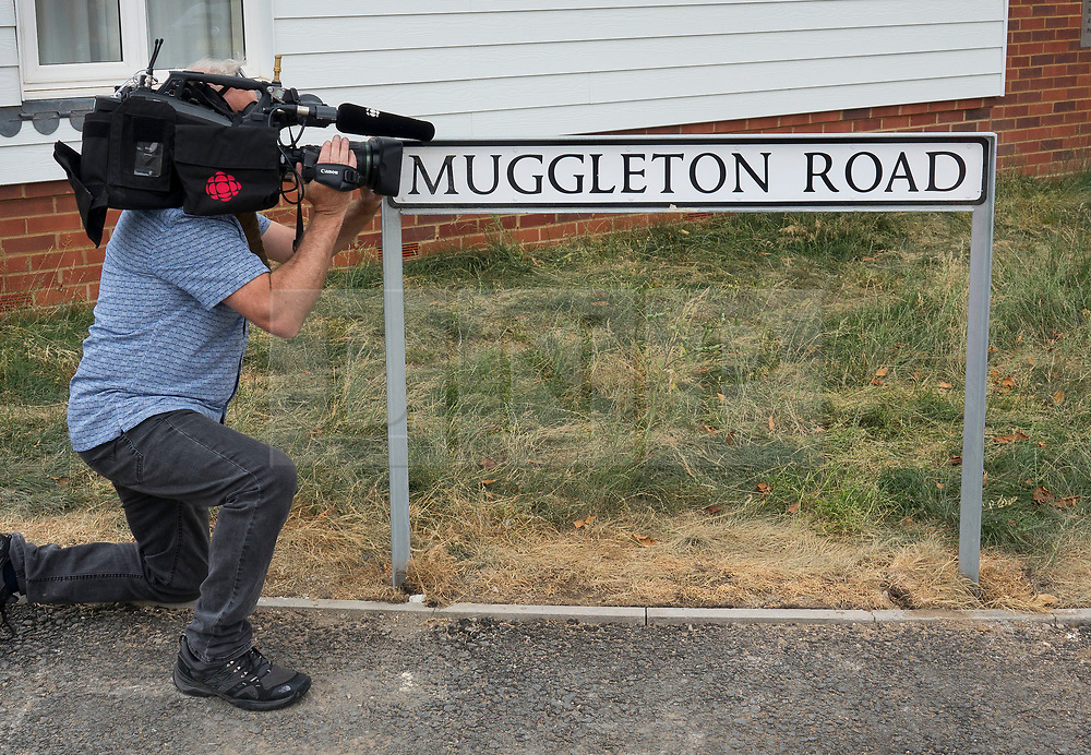 © Licensed to London News Pictures. 04/07/2018. Amesbury, UK. A TV camera man focuses on the road sign at Muggleton Road, Amesbury after a couple named locally as Dawn Sturgess, 44, and her partner Charlie Rowley, 45, were taken ill on Saturday 30th June 2018. Police have confirmed that the couple have been in contact with Novichok nerve agent. Former Russian spy Sergei Skripal and his daughter Yulia were poisoned with Novichok nerve agent in nearby Salisbury in March 2018.Photo credit: Peter Macdiarmid/LNP