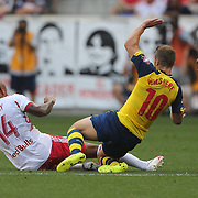 Thierry Henry, (left), New York Red Bulls, fouls Jack Wilshere, Arsenal, during the New York Red Bulls Vs Arsenal FC,  friendly football match for the New York Cup at Red Bull Arena, Harrison, New Jersey. USA. 26h July 2014. Photo Tim Clayton