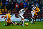 Motherwell FC Midfielder Stephen Pearson making a vital slide tackle during the Ladbrokes Scottish Premiership match between Motherwell and Dundee at Fir Park, Motherwell, Scotland on 12 December 2015. Photo by Craig McAllister.