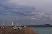 Rolled up umbrellas on Zlatni Rat Beach, Bracč Croatia
