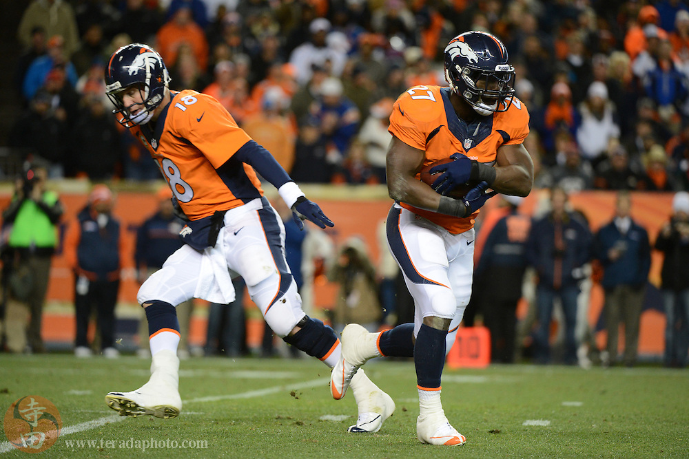 November 17, 2013; Denver, CO, USA; Denver Broncos running back Knowshon Moreno (27) runs with the football after a hand off from quarterback Peyton Manning (18) during the first quarter against the Kansas City Chiefs at Sports Authority Field at Mile High. The Broncos defeated the Chiefs 27-17.