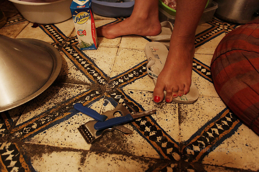 Detail - While we cook a tagine together Rachida, single mother of 31years old tells me about her son and her whole life -good an bad- in the kitchen of her rented home  Marrakech Medina - May 2013