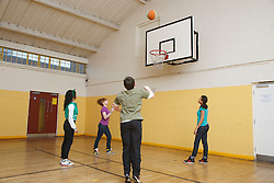 Teenagers at Youth Club playing basketball. Cleared for Mental Health Issues.