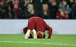 LIVERPOOL, ENGLAND - Friday, April 26, 2019: Liverpool's Mohamed Salah kneels to pray as he celebrates scoring the third goal during the FA Premier League match between Liverpool FC and Huddersfield Town AFC at Anfield. (Pic by David Rawcliffe/Propaganda)