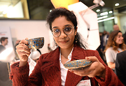 EDITORIAL USE ONLY Surabhi Mittal holds her functional Paper Mache Tea Set at this yearÕs International Student Innovation Awards at Central Saint Martins, London.