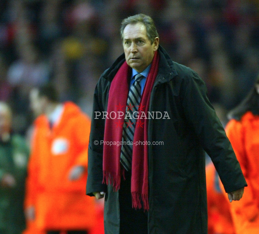 LIVERPOOL, ENGLAND - Saturday, January 10, 2004: Liverpool's manager Ge?rard Houllier watches from the touchline against Aston Villa during the Premiership match at Anfield. (Photo by David Rawcliffe/Propaganda)