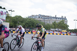 Hannah Barnes (GBR) of CANYON//SRAM Racing and Jip van den Bos (NED) of Parkhotel Valkenburg Cycling Team ride around the Arc de Triomphe during the La Course, a 89 km road race in Paris on July 24, 2016 in France.