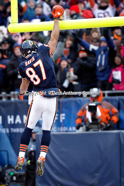 Chicago Bears tight end Kellen Davis (87) dunks the ball over the goal post bar after catching a fourth quarter touchdown pass that gives the Bears a 35-10 lead during the NFL 2011 NFC Divisional playoff football game against the Seattle Seahawks on Sunday, January 16, 2011 in Chicago, Illinois. The Bears won the game 35-24. ©Paul Anthony Spinelli
