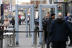 © Licensed to London News Pictures. 03/04/2019. London, UK. Spurs fan go through security barriers as they start to arrives at their £400 million new stadium as Tottenham Hotspur's will play their first competitive game against Crystal Palace this evening. Photo credit: Dinendra Haria/LNP