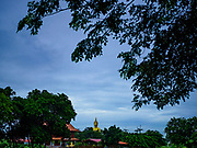 17 JULY 2017 - HUA TAPHON, ANG THONG, THAILAND: The big Buddha statue at Wat Muang in Ang Thong Province as seen from the highway near the temple. The statue stands 92 m (300 ft) high, and is 63 m (210 ft) wide. Construction started in 1990, and completed in 2008. It is made of concrete and painted gold. It is the largest statue in Thailand and one of the largest statues in the world. The temple is renowned for the Buddha statue and its statue garden, which represents the Thai version of a hellish afterlife.     PHOTO BY JACK KURTZ