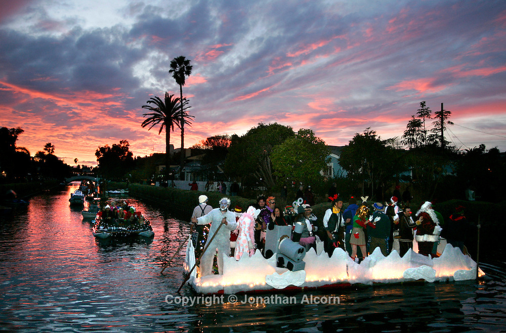 Dec 14, 2008 - Venice Beach, California, USA - Festive decorated boats and revelers take part in the 27th annual Venice Canals Christmas Boat Parade on Sunday December 14, 2008..(