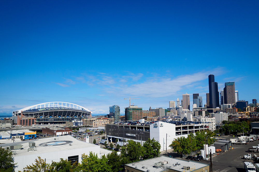 United States, Washington, Seattle. Skyline view of downtown Seattle and Century Link Stadium, home of the Seattle Seahawks football and Seattle Sounders FC soccer teams.