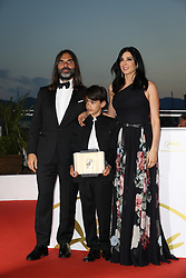 71st Cannes Film Festival Prizes Photocall. Lebanese director and actress Nadine Labaki (R), her husband Lebanese producer Khaled Mouzanar (L) and Syrian actor Zain al-Rafeea pose with the trophy on May 19, 2018 during a photocall after Labaki won the Jury Prize for the film Capharnaum at the 71st edition of the Cannes Film Festival. Photo by Shootpix/ABACAPRESS.COM
