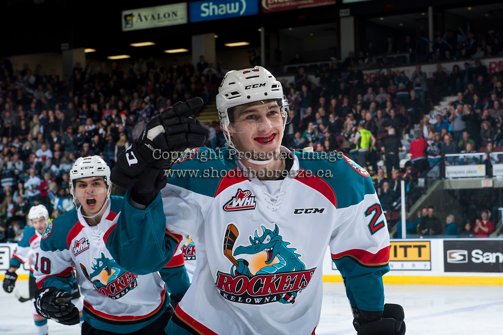 KELOWNA, CANADA - MARCH 25: Cal Foote #25 and Nick Merkley #10 of the Kelowna Rockets celebrate a first period goal against the Kamloops Blazers on March 25, 2017 at Prospera Place in Kelowna, British Columbia, Canada.  (Photo by Marissa Baecker/Shoot the Breeze)  *** Local Caption ***