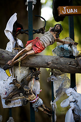 Small figures of Jesus hang on a fence in Ahuehuete, the first stop in the holy pilgrimage to Chalma.  It is believed that the water, which springs from underneath an enormous tree, is holy and that one should cleanse with it before arriving at the church in Chalma.