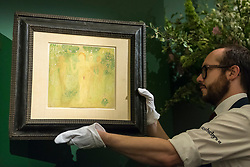 "© Licensed to London News Pictures. 01/06/2018. LONDON, UK. A Sotheby's technician presents ""The Secret of Temptation with Portrait of Ivan Kliun on the verso"", 1908, by Kazimir Severinovich Malevich (Est. GBP250-350k) at a preview of the Russian Pictures and Russian Works of Art, Fabergé & Icons sale which will take place at Sotheby's, New Bond Street on 5 June.  Photo credit: Stephen Chung/LNP"